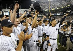 New York Yankees wave to fans after the Yankees beat the Baltimore Orioles 7-3 at Yankee Stadium in New York on Sunday, Sept. 21, 2008. The game is likely the final one at the stadium. (AP Photo/Ed Betz)
