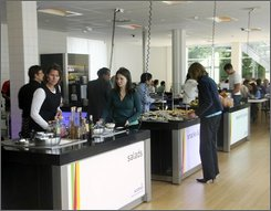 Customers choose their lunch at the cafeteria of the University in Wageningen, Netherlands, Thursday, Sept. 4, 2008. The 3 million euro (US$4.5 million) Restaurant of the Future is run by scientists of Wageningen University and Research Center to investigate the influences on eating behavior and to carry out studies for the food industry. Discreet ceiling cameras can zoom in on a face or a plate, or pull back to view a table or broad section of the lunchroom. They record not only what food you selected, but what you almost selected and how long you paused before deciding. Facial recognition software analyzes your level of enjoyment. In the control room, technicians watch the action on individual screens and on a large overhead screen. (AP Photo/ Arthur Max)