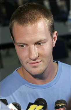 In this Aug. 1, 2008 file photo, North Carolina quarterback T.J. Yates listens to a question during football media day in Chapel Hill, N.C. Yates has a broken left ankle and is expected to miss at least six weeks of playing time. The sophomore was hurt on a sack in the third quarter of Saturday's Sept. 20, 2008 20-17 loss to Virginia Tech. (AP Photo/Gerry Broome, File)
