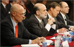 From left, Treasury Secretary Henry Paulson, Federal Reserve Chairman Ben Bernanke, Security and Exchange Commission (SEC) Chairman Christopher Cox, and Federal Housing Finance Agency Director James Lockhart testify on Capitol Hill in Washington, Tuesday, Sept. 23, 2008, before the Senate Banking Committee. (AP Photo/Charles Dharapak)