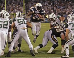 San Diego Chargers running back LaDainian Tomlinson splits the New York Jets defense for a 2-yard touchdown run during the third quarter of an NFL football game Monday, Sept. 22, 2008, in San Diego. The Chargers won 48-29.  (AP Photo/Lenny Ignelzi)