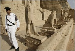 An Egyptian policeman guards at the entrance of the temple of Ramesses II, also known as the Great Temple at the temple complex of Abu Simbel, part of the UNESCO World Heritage Site southwest of Aswan, Egypt Tuesday, Sept. 23, 2008. German authorities are negotiating with kidnappers demanding millions in ransom after they snatched 11 European tourists and eight Egyptians during a Sahara desert safari trip in a remote southwestern corner of Egypt, the Egyptian tourism minister said Tuesday.  (AP Photo/Nasser Nasser)