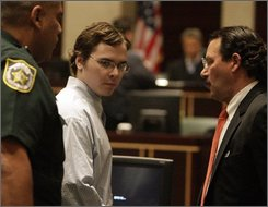 Michael Hernandez is escorted from the Orange County Courthouse in Orlando, Fla.  courtroom after a guilty verdict is read on Wednesday, Sept. 24, 2008.   Michael  Hernandez, 18, was convicted of first-degree murder  of  Jamie Gough, in 2004 at a Miami-Dade county school.   (AP Photo/Charles Trainor Jr., Pool)