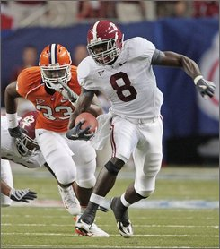 In this Aug. 30, 2008 file photo, Alabama's Julio Jones (8) outruns Clemson's Kavell Conner (33) in the first quarter of their NCAA college football game at the Georgia Dome in Atlanta. Jones and Georgia's A.J. Green, rated by some as the 1-2 receivers coming out of high school and already making a big impact, will face each other on Saturday, Sept. 27.(AP Photo/Dave Martin, File)