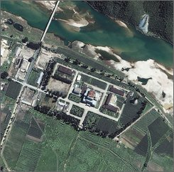 This Aug. 13, 2002 file photo is a  satellite image provided by Space Imaging Asia of the Yongbyon Nuclear Center, located north of Pyongyang, North Korea. The U.N. nuclear agency said Wednesday Sept. 24, 3008 that North Korea plans to reinsert nuclear material into its Yongbyon reactor. (AP Photo/Space Imaging Asia, File)