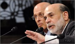 Federal Reserve Chairman Ben Bernanke, right, accompanied by Treasury Secretary Henry Paulson, testifies on Capitol Hill in Washington, Tuesday, Sept. 23, 2008, before the Senate Banking Committee hearing on the credit market turmoil. (AP Photo/Susan Walsh)