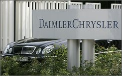 In this Feb. 15, 2007 file photo, a Mercedes-Benz limousine leaves the maingate of the DaimlerChrysler headquarters in Stuttgart, southwestern Germany. Germany's Daimler AG says it is in talks to sell its remaining stake in Chrysler LLC to private-equity firm Cerberus Capital Partners. Daimler spokesman Han Tjan on Wednesday, Sept. 24, 2008, confirmed a report in Germany's Manager Magazin that the company is in talks to sell the remaining 19.9 percent it owns in the U.S.-based automaker, but he declined to provide further details. (AP Photo / Thomas Kienzle)