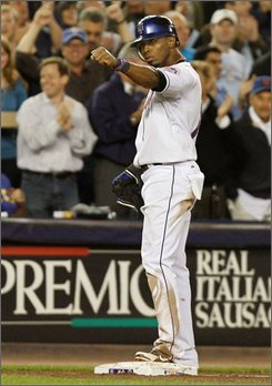 New York Mets' Jose Reyes pumps his fist toward the Mets dugout after a three-run triple during the sixht inning their baseball game against the Chicago Cubs at Shea Stadium in New York, Tuesday, Sept. 23, 2008. It was Reyes 200th hit of the season.  (AP Photo/Kathy Willens)