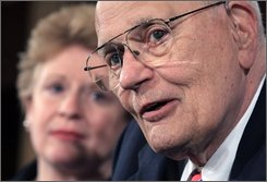 House Energy and Commerce Committee Chairman Rep. John Dingell, D-Mich., right, accompanied by Sen. Debbie Stabenow, D-Mich., meets with reporters on Capitol Hill in Washington, Wednesday, Sept. 24, 2008, to discuss a House budget plan expected to be considered by Congress that includes funding for $25 billion in loans for Detroit's automakers. (AP Photo/Lauren Victoria Burke)