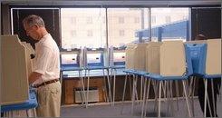 Gerry Biasiolli casts his ballot at the Urban Government Center in Louisville, Ky., Thursday, Sept. 18, 2008. Biasiolli was one of 12 voters who cast their ballots in the first half hour the center was open for early voting. (AP Photo/Patti Longmire)