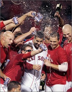 The Boston Red Sox celebrate on the field after beating the Cleveland Indians 5-4 to clinch a baseball playoff spot, Tuesday, Sept. 23, 2008, in Boston. (AP Photo/Michael Dwyer)