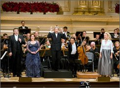  In this photo released by Carnegie Hall, Michael Tilson Thomas conducts the San Francisco Symphony with Thomas Hampson singing, left, and Yo-Yo Ma on cello at Carnegie Hall for it's Opening Night Gala concert, Wednesday, September 24, 2008, in New York. Carnegie Hall opened its 118th season with a celebration of Bernstein, the conductor, composer, musical Confucius and mentor who died 18 years ago at age 72. (AP Photo/ Carnegie Hall, Chris Lee)