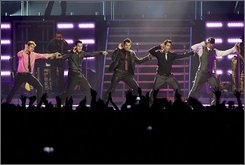 New Kids on the Block Joey McIntyre, left to right, Jonathan Knight, Jordan Knight, Danny Wood and Donnie Wahlberg appear on stage at Air Canada Centre in Toronto, on Friday September 19 2008. (AP Photo/Canadian Press,Chris Young)