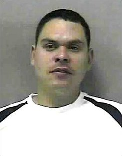In this undated photo released by the South Central Regional Jail, Jose A. Cruz is shown. Cruz, 34, who police said passed gas and fanned it toward a patrolman has been charged with battery on a police officer. Cruz, of Clarksburg, W.Va., was pulled over early Tuesday, Sept. 23, 2008, for driving without headlights, police said. (AP Photo/South Central Regional Jail)