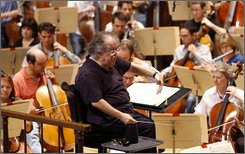 James Levine, Boston Symphony Orchestra music director, conducts the symphony during the dress rehersal, Wednesday, Sept. 24, 2008, in Boston. Levin last conducted the BSO in the opening concerts at Tanglewood in July, but had to bow out of the remainder of the 2008 Tanglewood season to undergo surgery to remove a kidney. (AP Photo/Bizuayehu Tesfaye)