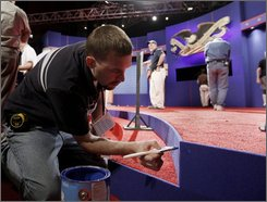  Jason Griffin prepares the site for the Presidential Debate, Thursday, Sept. 25, 2008, at the University of Mississippi in Oxford. The first debate between the presidential nominees, Republican John McCain and Democrat Barack Obama, is scheduled for Friday. (AP Photo/Charles Dharapak)