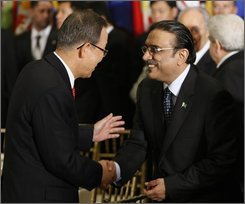 United Nations Secretary General Ban Ki-moon, left, greets Pakistani President Asif Ali Zardari, left, before dinner at the United Nations, Tuesday, Sept. 23, 2008. in New York. (AP Photo/Pablo Martinez Monsivais)