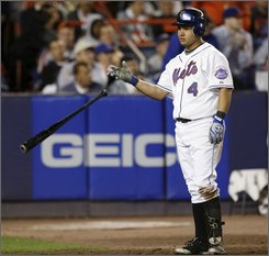 New York Mets' Argenis Reyes tosses his bat after striking out swinging for the final out of the sixth inning in the Mets' 9-6 loss to the Cubs in a baseball game at Shea Stadium in New York, Wednesday, Sept. 24, 2008. (AP Photo/Kathy Willens)