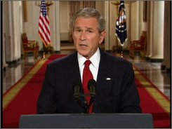 In this video image from APTN, President Bush speaks in a prime-time address from the Cross Hall of the White House in Washington, Wednesday, Sept. 24, 2008. (AP Photo/APTN)