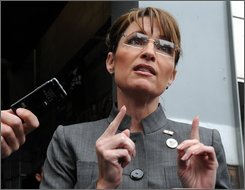 Republican vice presidential candidate Sarah Palin talks to reporters outside of Engine Company 10, Ladder Company 10 next to the World Trade Center site, Thursday, Sept. 25, 2008 in New York. (AP Photo/Henny Ray Abrams)