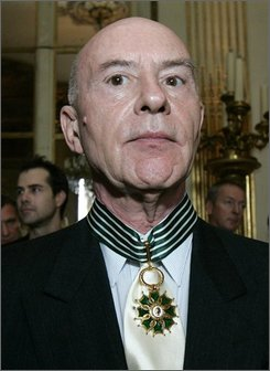 In this June 27, 2008 file photo, German-born music conductor Christoph Eschenbach poses after he was awarded Commander in the Arts and Letters  Order in Paris. (AP Photo/Jacques Brinon, file)