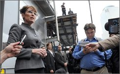 Republican vice presidential candidate Sarah Palin talks to reporters outside of Engine Company 10, Ladder Company 10 next to the World Trade Center site, Thursday, Sept. 25, 2008, in New York. (AP Photo/Henny Ray Abrams)