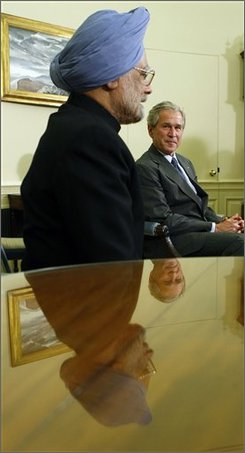 President Bush, right, with Indian Prime Minister Manmohan Singh, left, during their meeting in the Oval Office of the White House, Thursday, Sept. 25, 2008 in Washington. (AP Photo/Pablo Martinez Monsivais)