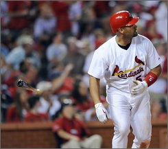 St. Louis Cardinals' Albert Pujols watches his two-run home run in the fifth inning against the Cincinnati Reds in a baseball game Friday, Sep. 26, 2008 in St. Louis. (AP Photo/Bill Boyce)