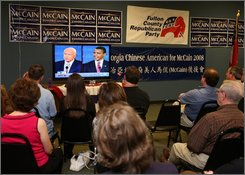 A viewing party of the presidential debate takes place Friday, Sept. 26, 2008 in Sandy Springs, Ga. at the Fulton County Republican Party headquarters.  (AP Photo/Jenni Girtman)