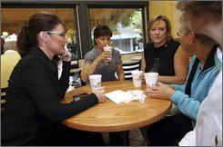 Republican vice presidential candidate, Alaska Gov. Sarah Palin, left, has coffee with Nancy Harding, second from left, Julie Devitt, third from left, Lee Anthony, right, and Maureen Snook, in center city Philadelphia, Sunday, Sept. 28, 2008.  All four are mothers of active duty military personnel. (AP Photo/Joseph Kaczmarek)