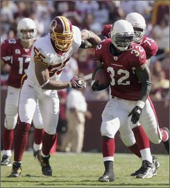 Washington Redskins defensive end Jason Taylor (55) chases Arizona Cardinals running back Edgerrin James (32) in the third quarter of an NFL football game in Landover, Md., Sunday, Sept. 21, 2008. What seemed like an annoying kick in the calf during the second quarter Sunday turned into a significant medical issue for Taylor, who underwent a 20-minute emergency procedure Monday and will miss next week's game against the Dallas Cowboys. (AP Photo/Lawrence Jackson)