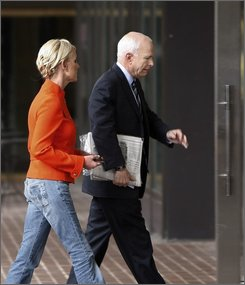 Republican presidential candidate, Sen. John McCain, R-Ariz., arrives at his campaign headquarters with his wife Cindy in Arlington, Va., Sunday, Sept. 28, 2008. (AP Photo/Gerald Herbert)