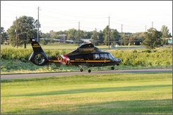 In this August 2008 photo provided by the Prince George's County Fire Department, the Maryland State Police Trooper 2 medevac helicopter is seen in Beltsville, Md. The medevac helicopter crashed in suburban Washington early Sunday, Sept. 28, 2008 while taking accident victims to a trauma center killing four of the five people aboard, authorities said. (AP Photo/Prince George's County Fire Dept.)