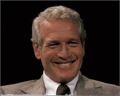 """In this 1978 file photo, actor and U.N. ambassador to disarmament Paul Newman is seen. Newman, the Academy-Award winning superstar who personified cool as an activist, race car driver, popcorn impresario and the anti-hero of such films as """"Hud,"""" """"Cool Hand Luke"""" and """"The Color of Money,"""" has died, a spokeswoman said Saturday. He was 83. Newman died Friday, Sept. 26, 2008, of cancer, spokeswoman Marni Tomljanovic said. (AP Photo)"""