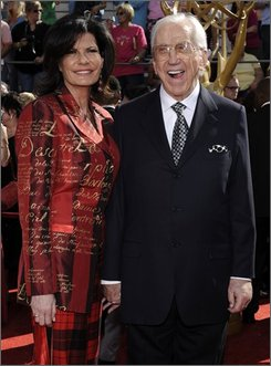 Ed McMahon and his wife, Pam Hurn, arrive for the 60th Primetime Emmy Awards in Los Angeles, Sunday, Sept. 21, 2008. Court documents show a company founded by television icon Merv Griffin is suing Ed McMahon for a $100,000 loan it claims has gone unpaid. (AP Photo/Chris Pizzello)