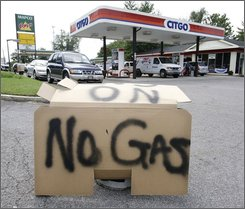 A sign announcing that a filling station is out of gas is displayed in Nashville, Tenn., Sept. 19, 2008. Pipelines supplying Nashville with gasoline were running at full capacity after a shortage that officials said was spurred by panic buying. The short-lived fuel shortage in the Nashville area has many motorists here scratching their heads about why the shortage appeared to be leading some drivers to panic. (AP Photo/Mark Humphrey)