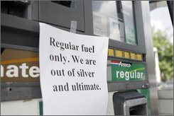 A sign on a gas pump in Atlanta on Monday, September 29, 2008, informs drivers the station is out of two of three types of gasoline. As the gasoline shortage in the Southeast enters its third week, drivers in Georgia and the Carolinas waited in lines Monday and paid at least 15 cents more for a gallon of gas than elsewhere in the country. (AP photo/Jason Bronis)