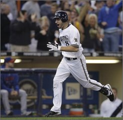 Milwaukee Brewers' Ryan Braun reacts as he rounds the bases after hitting a two-run home run during the eighth inning of a baseball game against the Chicago Cubs on Sunday, Sept. 28, 2008, in Milwaukee. (AP Photo/Morry Gash)