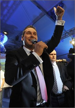 Heinz Christian Strache, top candidate of the right-wing Freedom Party, FPOE, gestures, while delivering a statement at their party's tent in downtown Vienna, on Sunday, Sept. 28, 2008. Initial projections from Austria's parliamentary elections Sunday indicate the Social Democrats are poised for victory, though the real winners may turn out to be the country's two far-right parties. (AP Photo/Kerstin Joensson)
