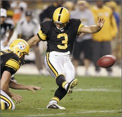 Pittsburgh Steelers kicker Jeff Reed, right, kicks the game-winning field goal out of the hold by Mitch Berger in overtime against the Baltimore Ravens in an NFL football game in Pittsburgh, Tuesday, Sept. 30, 2008. The Steelers won 23-20. (AP Photo/Keith Srakocic)