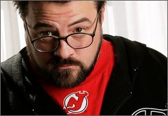 "In this Sept. 8, 2008 file photo, director Kevin Smith from the film ""Zack and Miri Make a Porno"" poses for a portrait during the International Film Festival in Toronto. (AP Photo/Carlo Allegri, file)"