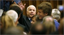 Republican presidential candidate Sen. John McCain, R-Ariz., waves to supporters after speaking at a small business roundtable discussion, Tuesday, Sept. 30, 2008, in Des Moines, Iowa. (AP Photo/Charlie Neibergall)