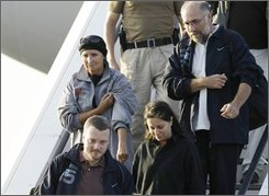 Released German hostages, of whom no names were made public, leave an airplane at the airport Tegel in Berlin, Germany, Sept. 30, 2008. Five Germans who were part of a 19-member tourist group kidnapped in Egypt and taken by their abductors on a dash through the Sahara Desert and returned to their home countries on Tuesday. (AP Photo/Herbert Knosowski)