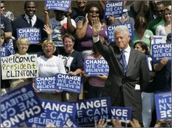 Former President Bill Clinton waves to supporters after campaigning for Democratic presidential nominee Barack Obama at the University of Central Florida in Orlando, Fla., Wednesday, Oct. 1, 2008.  (AP Photo/John Raoux)