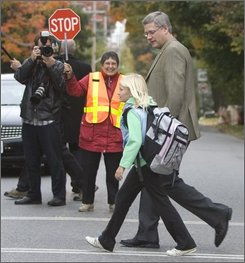 Conservative Party leader Stephen Harper walks his daughter Rachel to school, in Ottawa, Tuesday Sept. 30, 2008. The Canadian prime minister was  accused by Canada's main opposition party on Tuesday  of plagiarizing a speech in 2003 that urged the country to join the U.S.-led war in Iraq.(AP Photo/The Canadian Press,Tom Hanson)