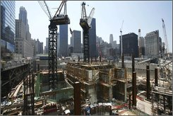 In this file photo of Friday, June 20, 2008, construction cranes work above the Freedom Tower foundations at the World Trade Center site in New York. The Port Authority of New York and New Jersey's executive director, Chris Ward, announced Monday that nearly every project under construction at the World Trade Center site, which the agency owns, is behind schedule and that the Freedom Tower memorial would not be able to open by its latest target, Sept. 11, 2011. (AP Photo/Mark Lennihan, File)