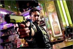 "In this image released by Warner Bros., Jeffrey Dean Morgan stars as The Comedian in a scene from the film, ""Watchmen."" (AP Photo/Warner Bros. Clay Enos)"