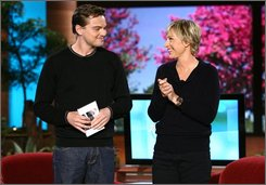 "In this image released by Warner Bros., actor Leonardo DiCaprio, left, talks with host Ellen DeGeneres about the public service announcement he put together with some of his Hollywood friends including DeGeneres to encourage people to vote for the upcoming election during the taping of ""The Ellen DeGeneres Show,"" Wednesday, Oct. 1, 2008, in Burbank, Calif. The program is scheduled to air on Thursday, Oct. 2.  (AP Photo/Warner Bros.Michael Rozman)"