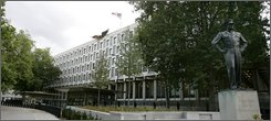 """The United States Embassy in Grosvenor Square in central London, Thursday, Oct. 2, 2008, with a statue of U.S. President Eisenhower, at right. The U.S. ambassador to Britain said Thursday that the United States plans to leave its landmark embassy in central London's tony Mayfair district and build a safer facility in less salubrious surroundings south of the River Thames. The move, which will end a 200-year U.S. association with London's Grosvenor Square, is part of American efforts to secure diplomatic staff in compounds - a push that began after deadly al-Qaida bombings at U.S. embassies in East Africa a decade ago.  Ambassador Robert Tuttle said the State Department had agreed to buy a 5 acre (2 hectare) site at Nine Elms in the Wandsworth area and that the existing embassy building would be put up for sale """"almost immediately."""" (AP Photo/Alastair Grant)"""
