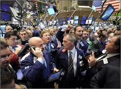 Traders crowd the post that handles General Electric on the floor of the  New York Stock Exchange, Thursday Oct. 2, 2008. (AP Photo/Richard Drew)